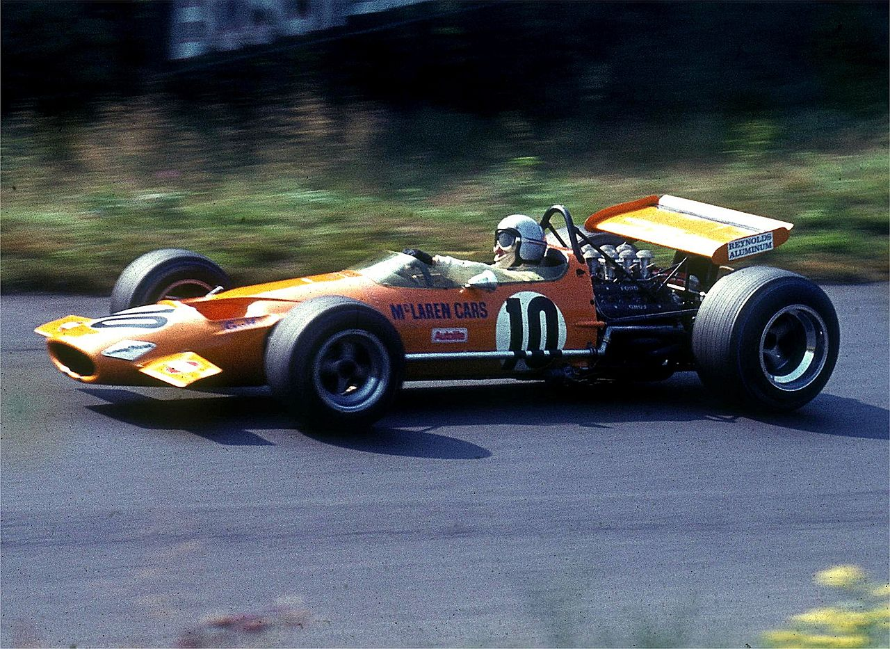 The M7 car of 1968 gave McLaren their first Formula One wins. It is driven here by Bruce McLaren at the Nürburgring in 1969.