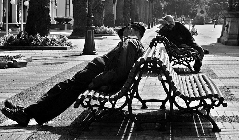 A couple of guys sleeping near the Kiosko Alfonso in A Corua (Galicia, Espaa.)