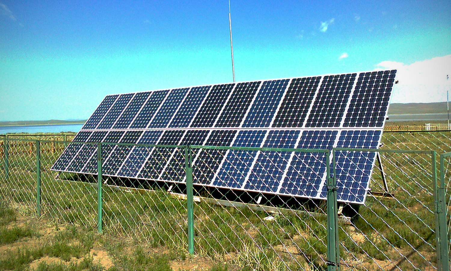 Solar panel installation at an information center adjacent to Ögii Lake