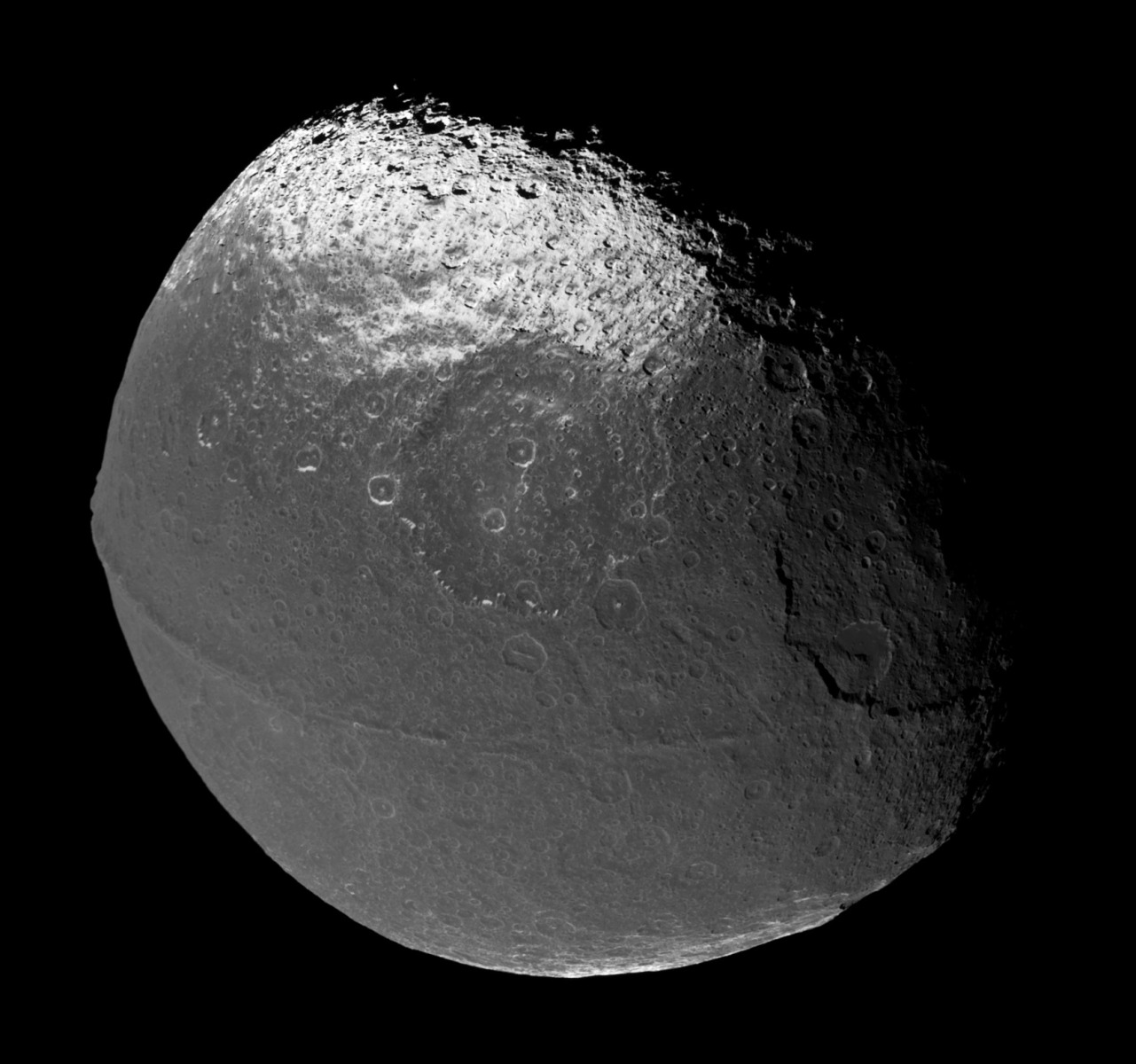 Mosaic of Iapetus images taken by the Cassini spacecraft, Dec. 31, 2004. Photomosaic assembled by Matt McIrvin.