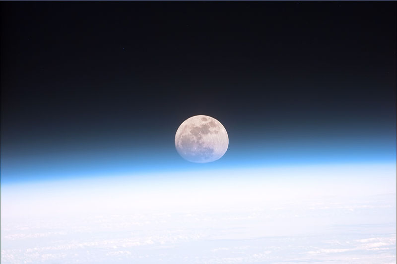 The moon partially obscured by the atmosphere