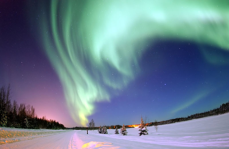Eielson Air Force Base, Alaska -- The Aurora Borealis, or Northern Lights, shines above Bear Lake