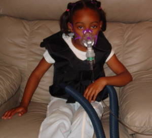 An example of a breathing treatment for a younger Cystic fibrosis patient.