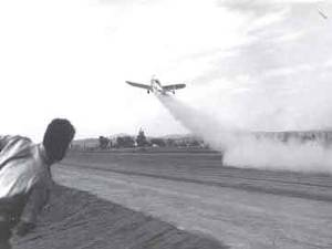 Figure 3: Jack Parsons rushes to measure the take-off distance for his rocket-powered Ercoupe plane in 1941.