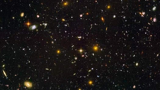 Figure 4: Hubble Ultra Deep Field. Recently, astronomers using the Hubble unveiled the deepest look into the universe yet, showing what could be the most distant and the youngest galaxies ever seen.