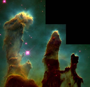 Figure 2: The Eagle Nebula. On 1 April 1995, the Hubble took this famous photograph of pillar-like structures in the Eagle Nebula. These pillars are actually columns of interstellar hydrogen gas and dust that lead to star formation.