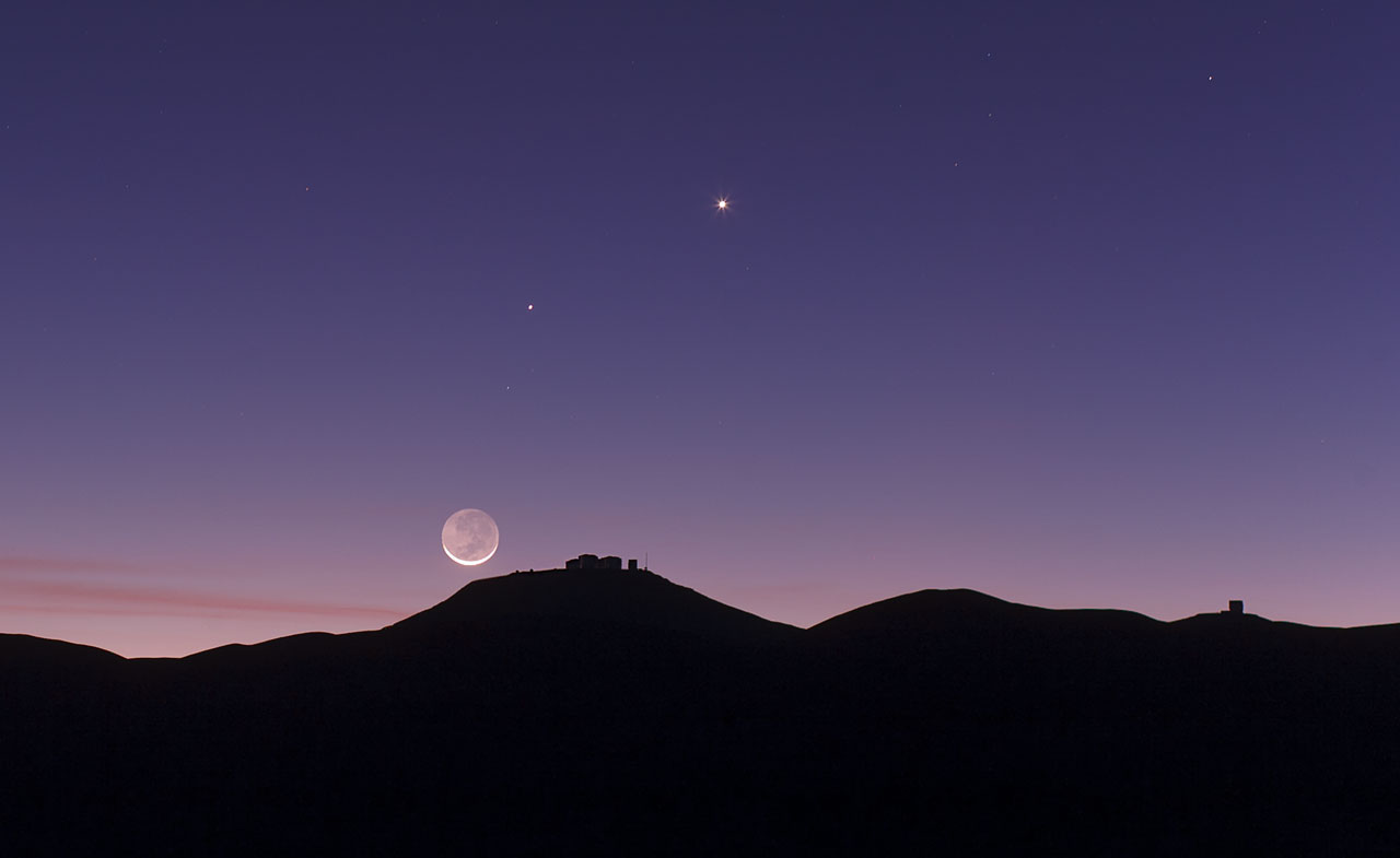 The crescent Moon and earthshine over ESO's Paranal Observatory.