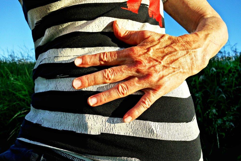 A hand on the abdomen