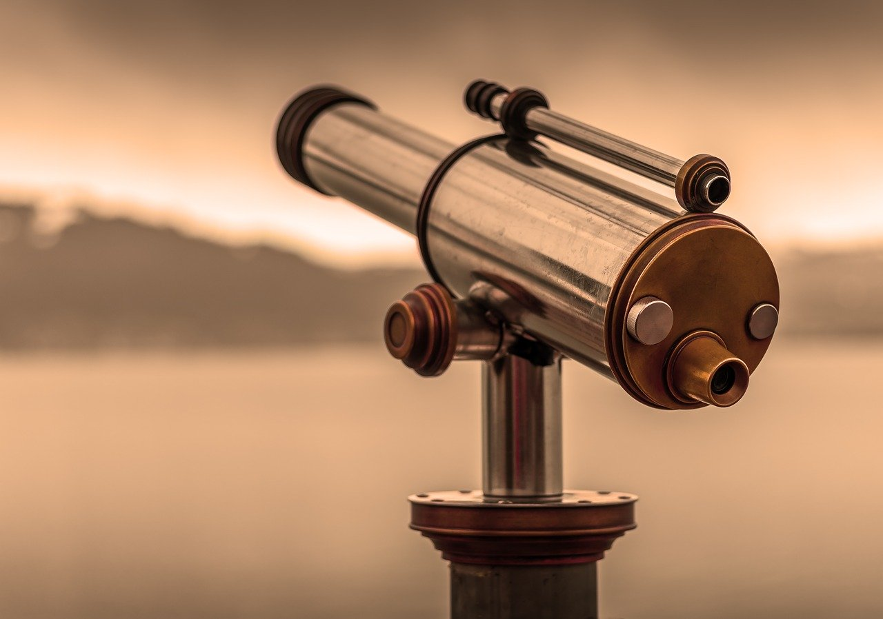 A telescope with a sepia filter over the image