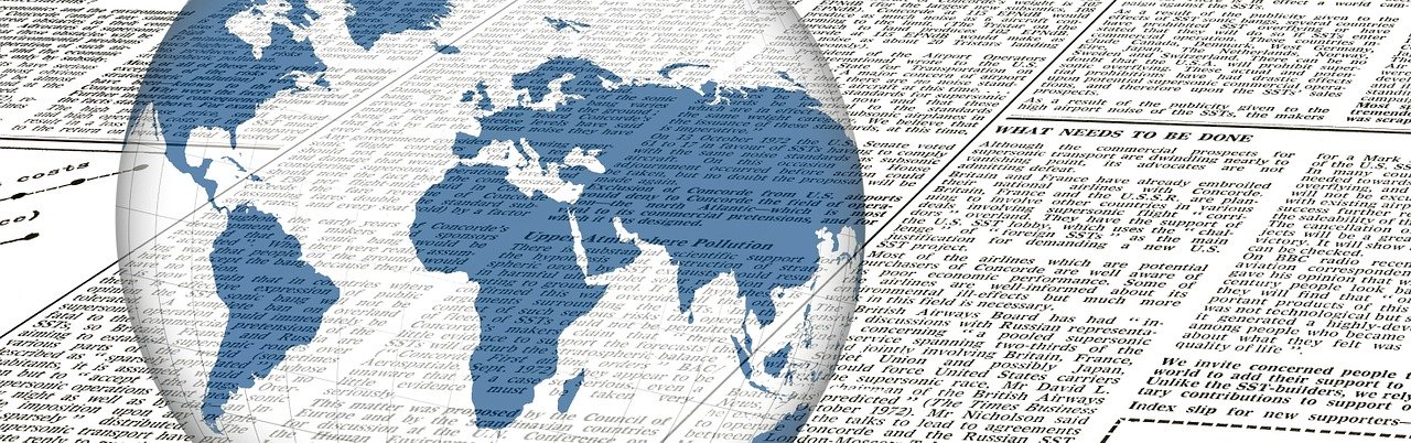 image of a newspaper and a globe