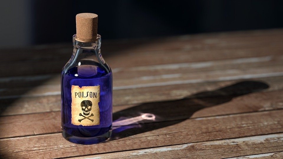 A bottle marked with a skull and crossbones, and the word poison, containing a dark purple liquid