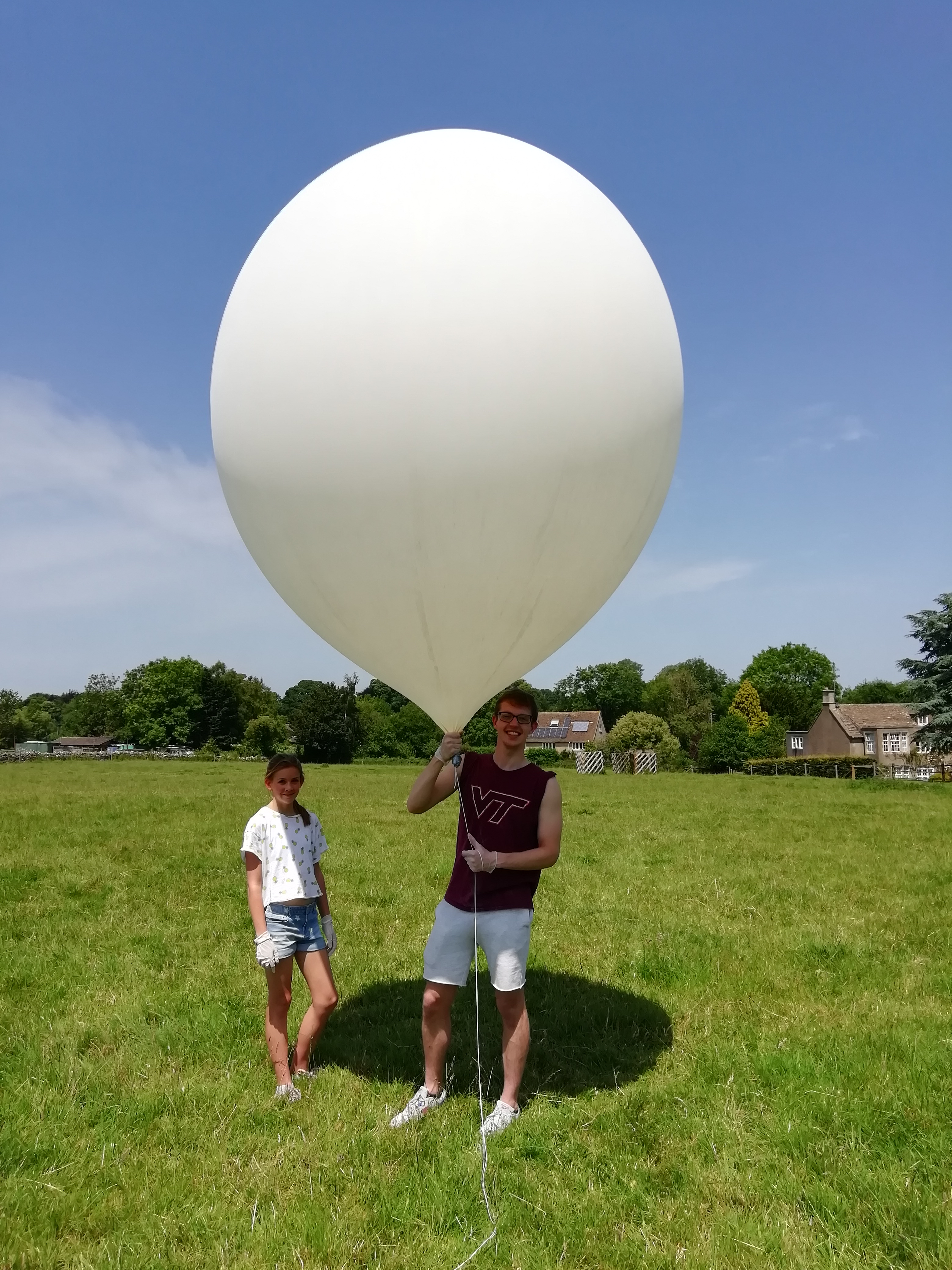 Amelia and Matthew are given the job of hanging onto the inflated balloon until we were ready to launch