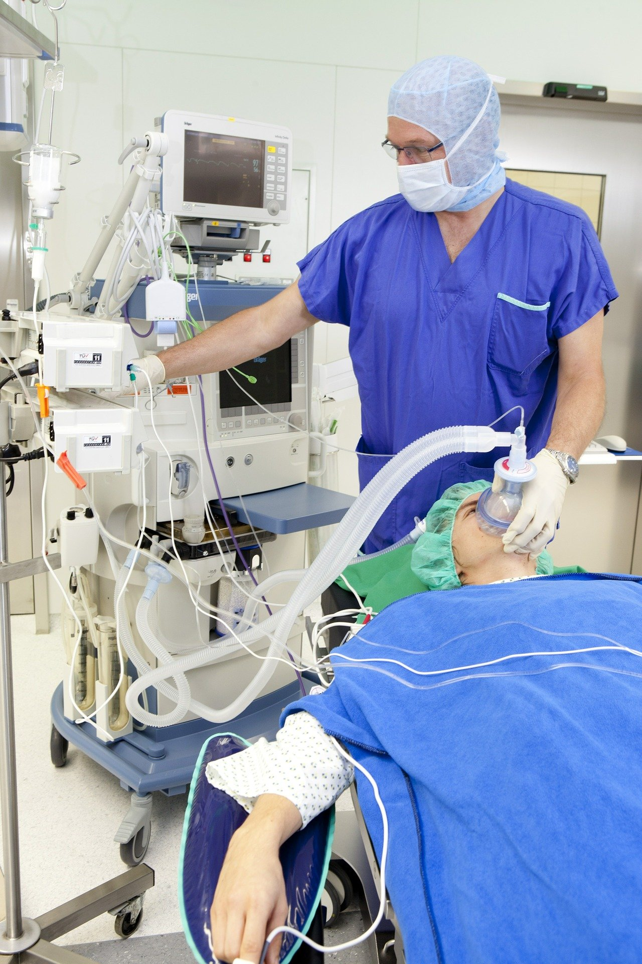A patient on a ventilator in a hospital.