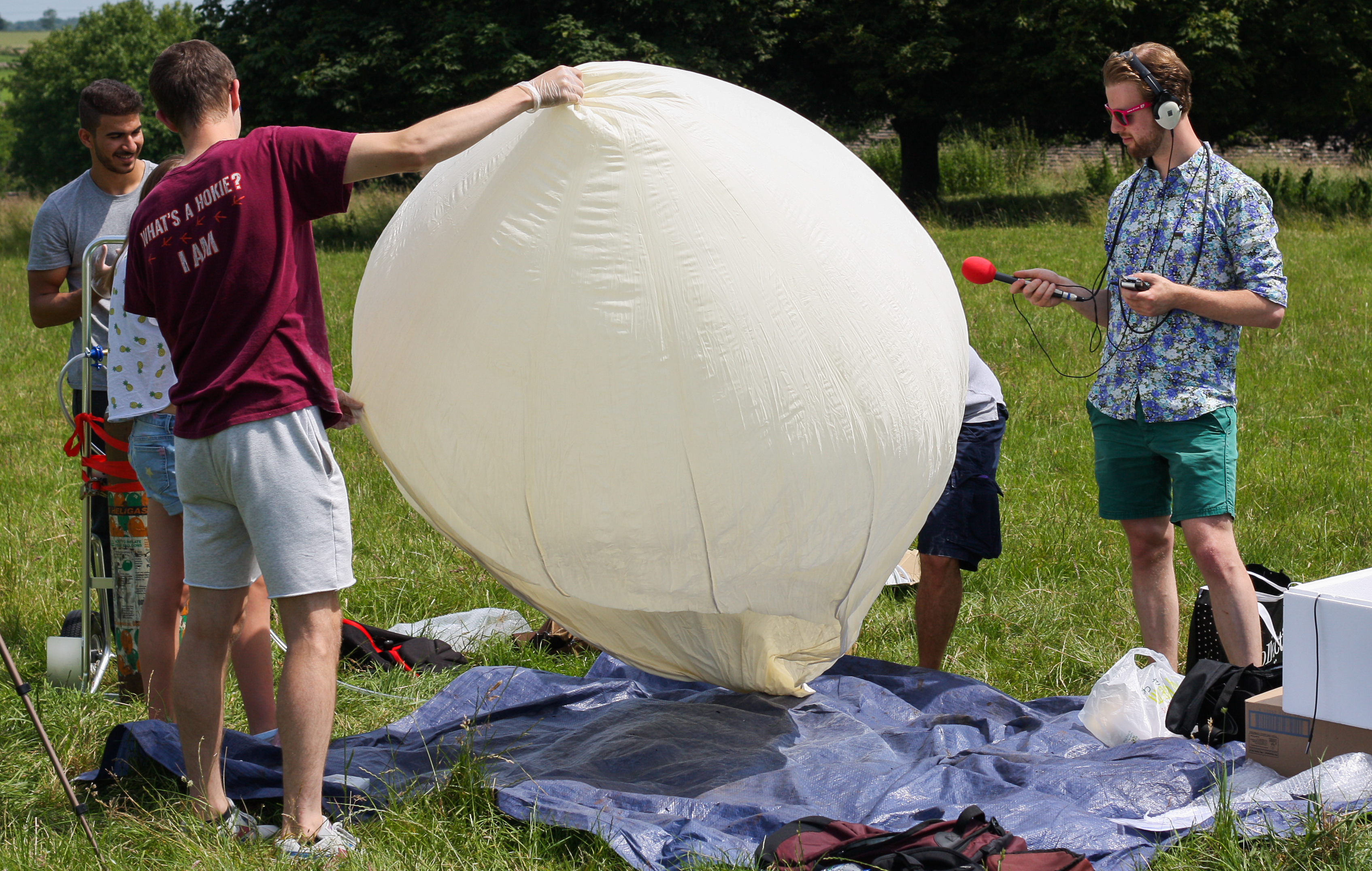 The team begin to inflate the helium balloon that will carry the screams to the edge of space