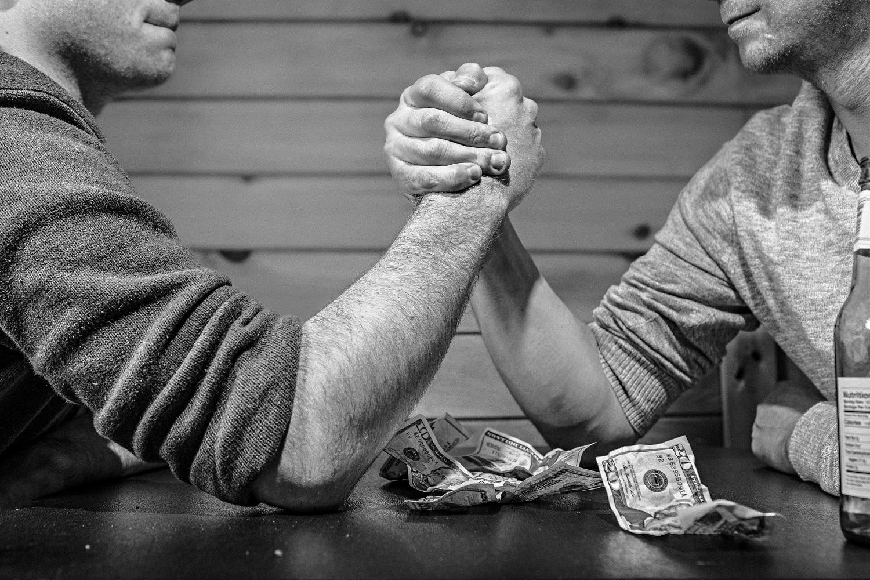 Men arm-wrestling