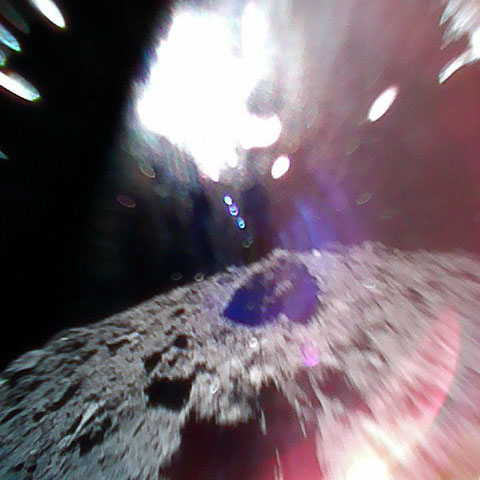 A picture taken by rover MINERVA-II-1 on the surface of Ryugu during a hop