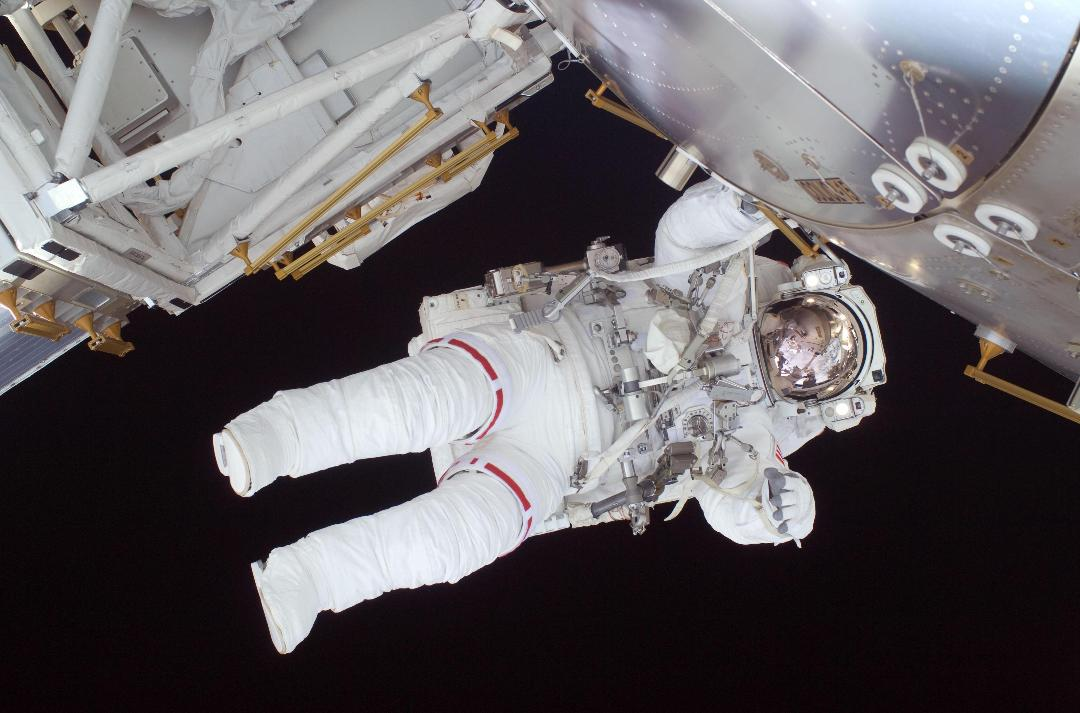 Nicole Stott spacewalks from the International Space Station