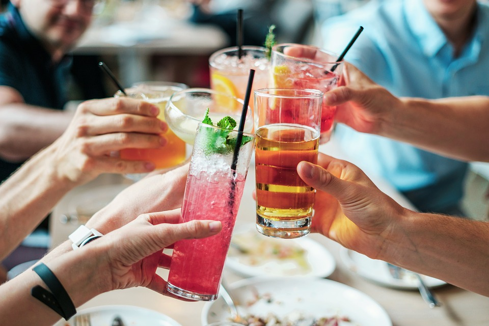 Group of alcoholic drinks held up by group