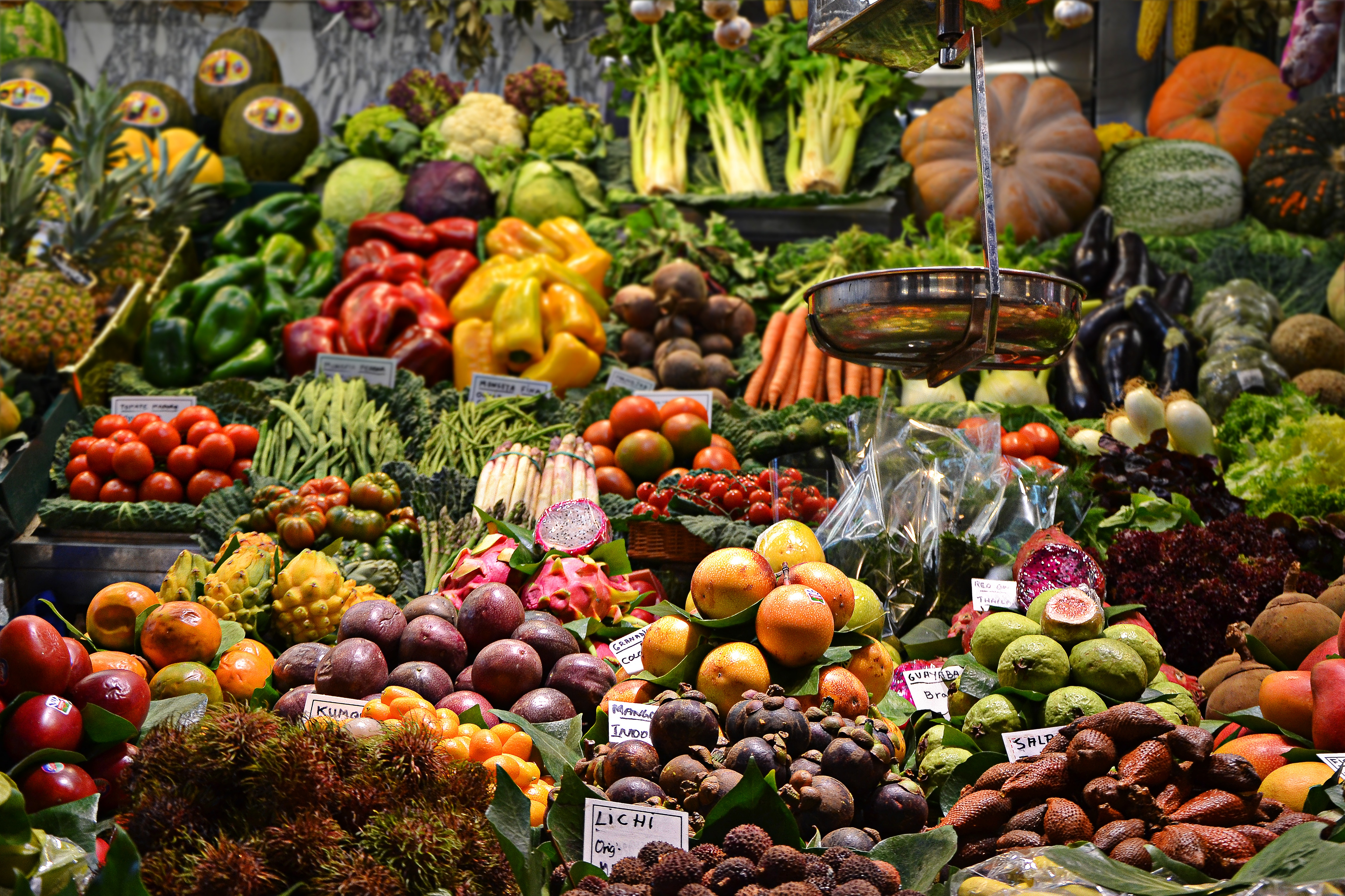 A food market with a wide array of different vegetables