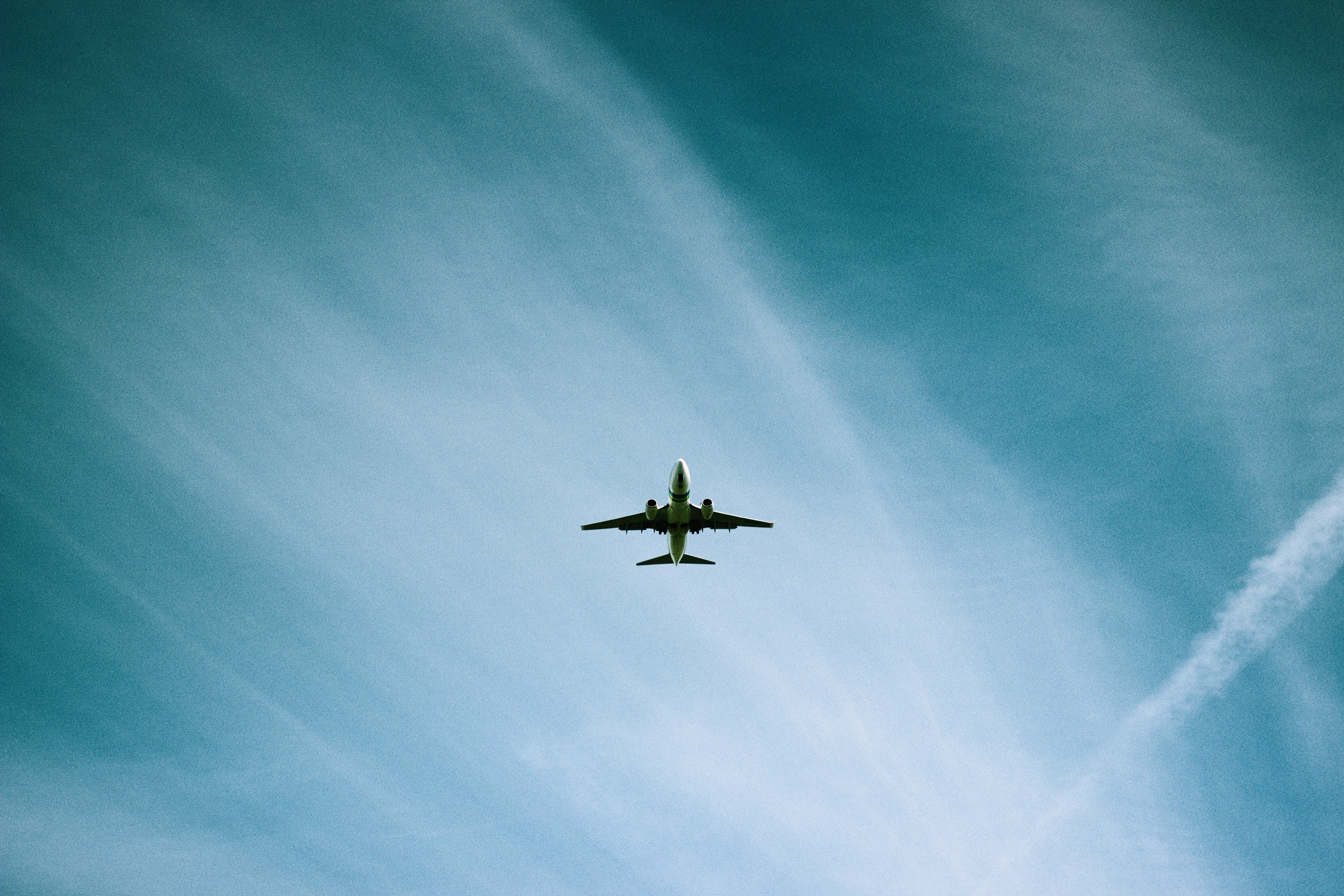 Plane flying through light clouds