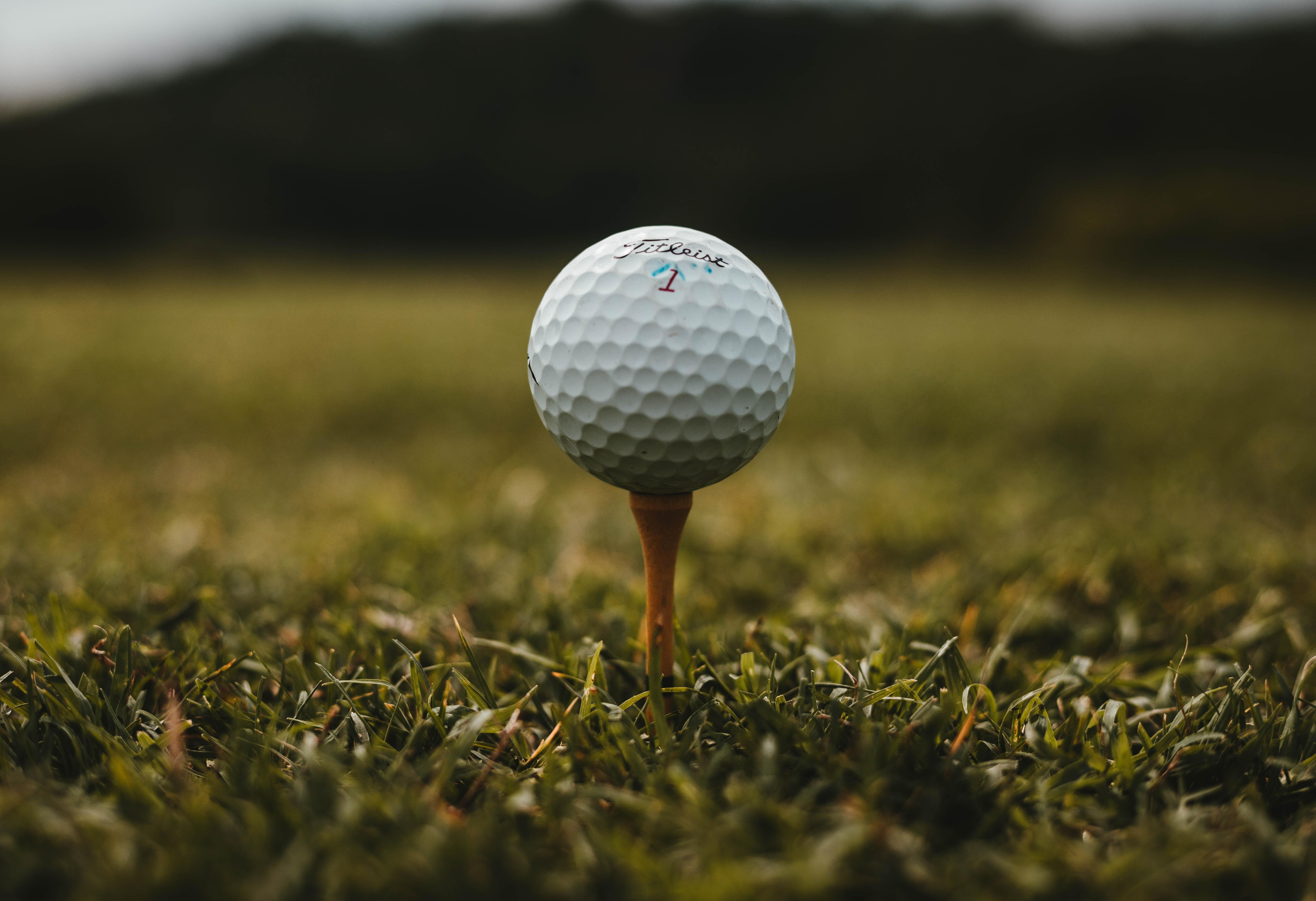A golf ball on a tee