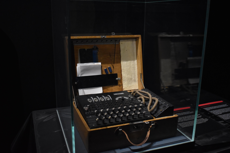 An enigma codebreaking machine behind glass