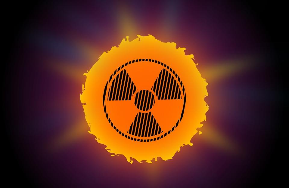 radioactivity symbol overlaid on the sun