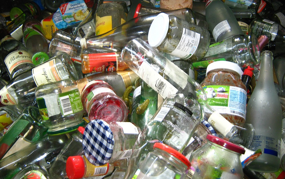 Empty glass bottles and jars in a pile for recycling.
