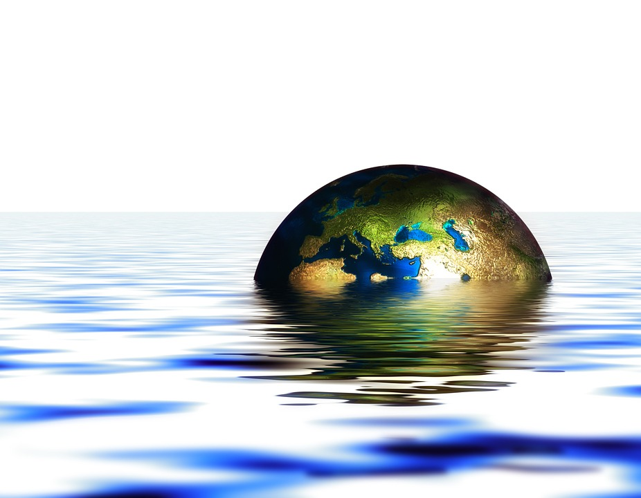 The Earth sinking in water.