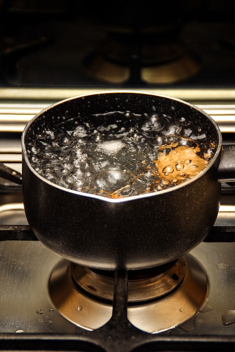 A pot of boiling water on a stove