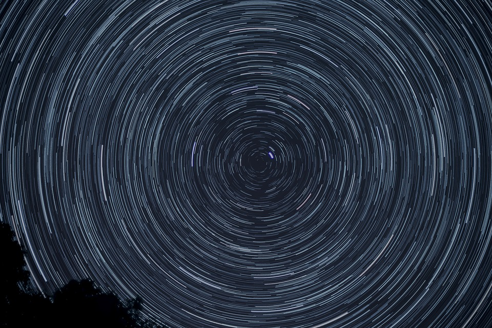 Star trails photographed at night with a long exposure
