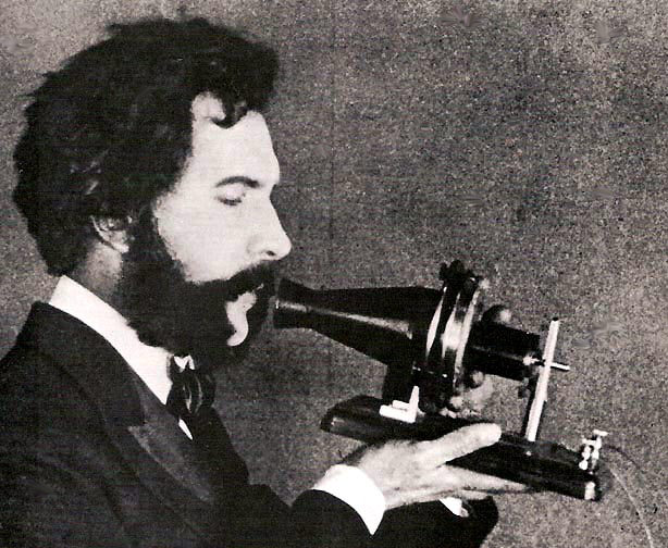 Alexander Graham Bell speaking into a prototype telephone