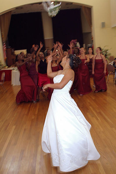 A bride tossing her bouquet of flowers