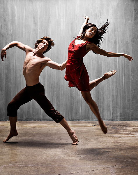 A man and a woman performing a modern dance.