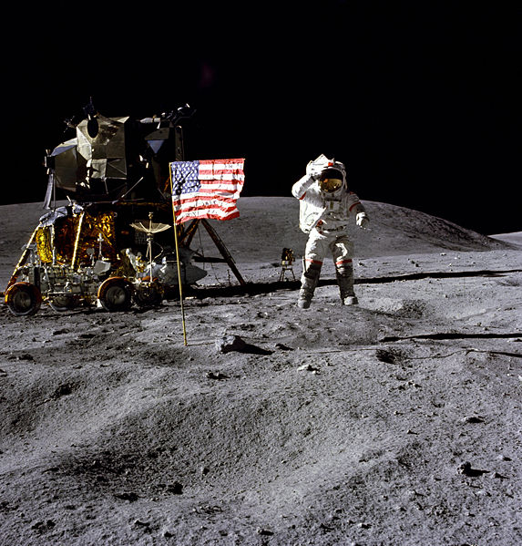 John W. Young on the Moon during Apollo 16 mission. Charles M. Duke Jr. took this picture. The LM Orion is on the left. April 21, 1972