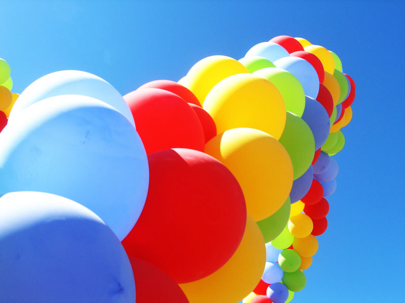 An arch of colourful party balloons