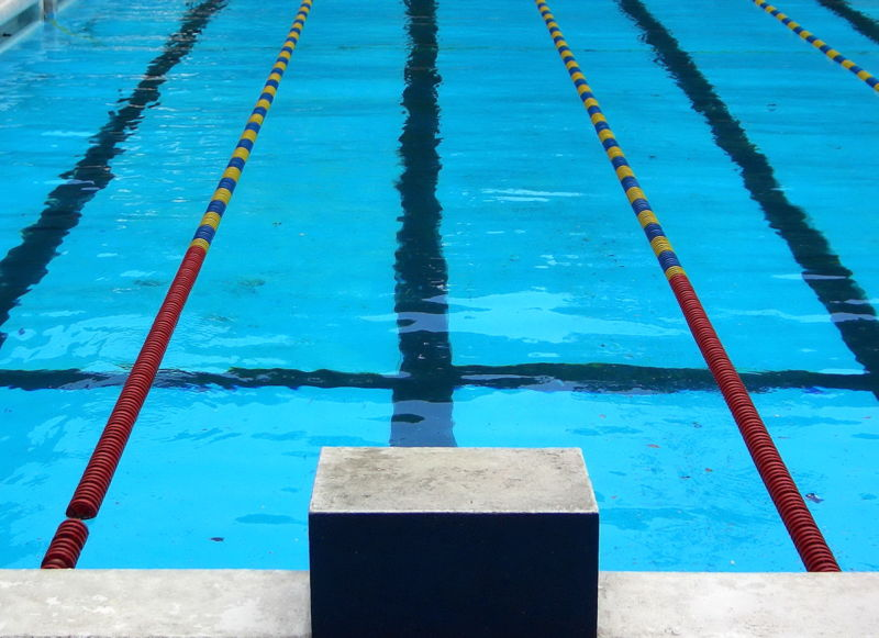 View from the starting block of a competition swimming pool.