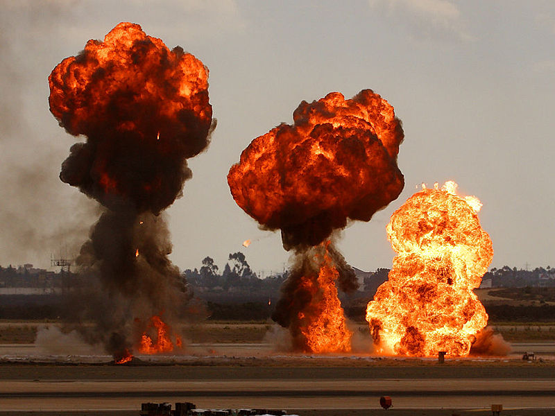 Gasoline explosions, simulating bomb drops at an airshow.