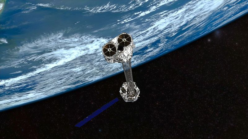 Artist's concept of NuSTAR on orbit. NuSTAR has a 10-m (30') mast that deploys after launch to separate the optics modules (right) from the detectors in the focal plane (left). The spacecraft, which controls NuSTAR's pointings, and the solar panels...