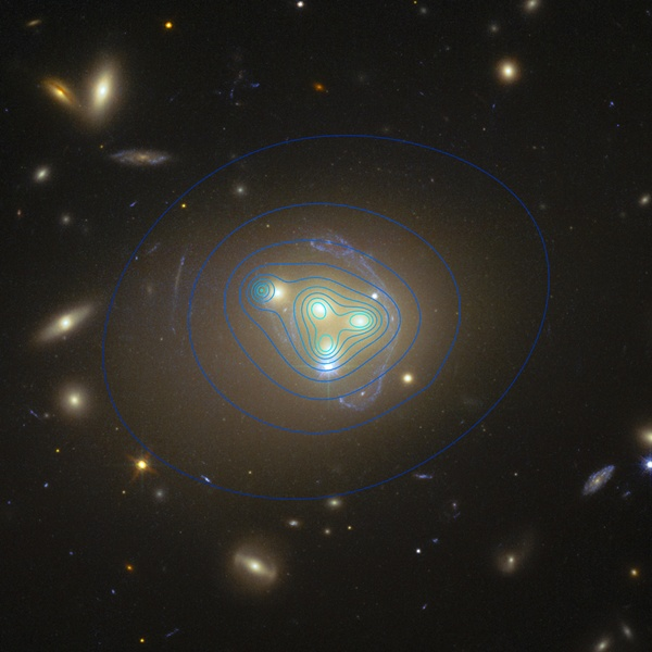 The galaxy cluster Abell 3827. The distribution of dark matter is shown with blue lines.