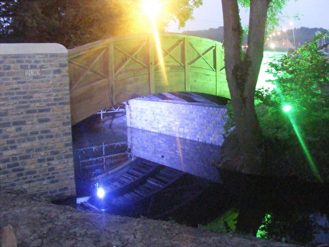 Bella's Bridge over the Whitelake River, on the site of the Glastonbury Festival. Illuminated with coloured lights