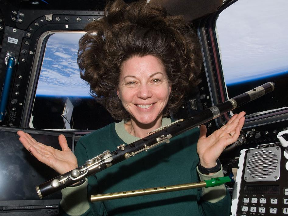 NASA's Cady Coleman playing the flute in space