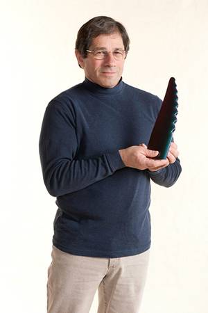 Frank Fish with a model of a humpback whale fin