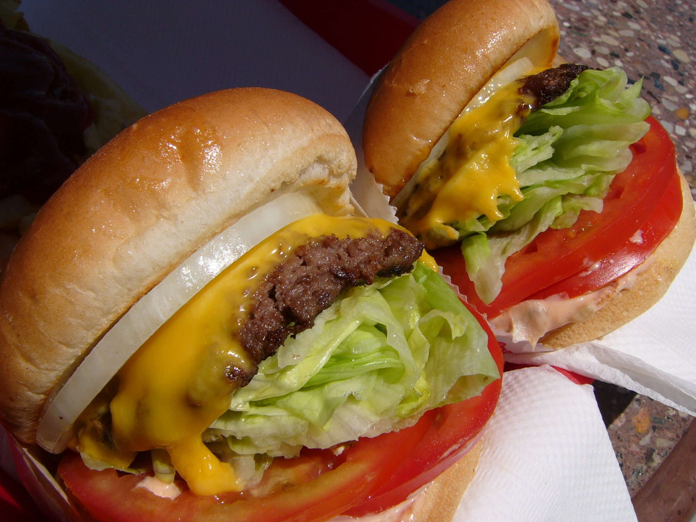 A pair of In-N-Out cheeseburgers