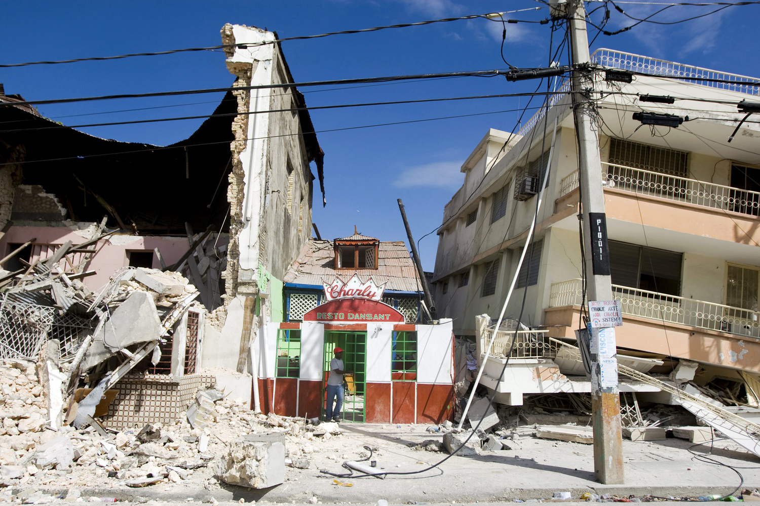 A man exits a restaurant after he looked for his belongings. An earthquake rocked Port au Prince on January 12, 2010.