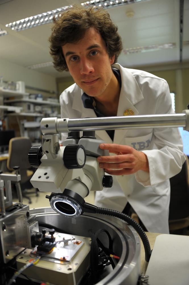 IBM scientist Colin Rawlings makes adjustments to nanopatterning tool.