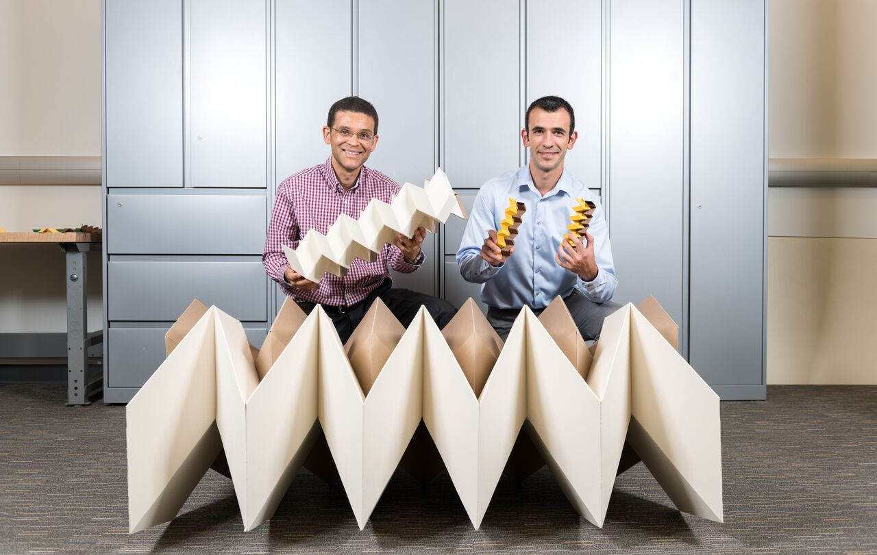 Glaucio Paulino and Evgueni Filipov with the zippered tubes