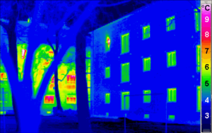 Thermal imaging of a Passive House, with a conventional building in the background