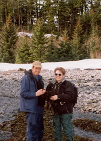 Bruce Wright accompanied Jane Lubchenco, the past president of the American Association for the Advancement of Sciences (AAAS), on a trip to one of Alaska's remote beaches. Lubchenco, a marine ecologist, is inspecting some marine algae washed up on shore by winter storms.