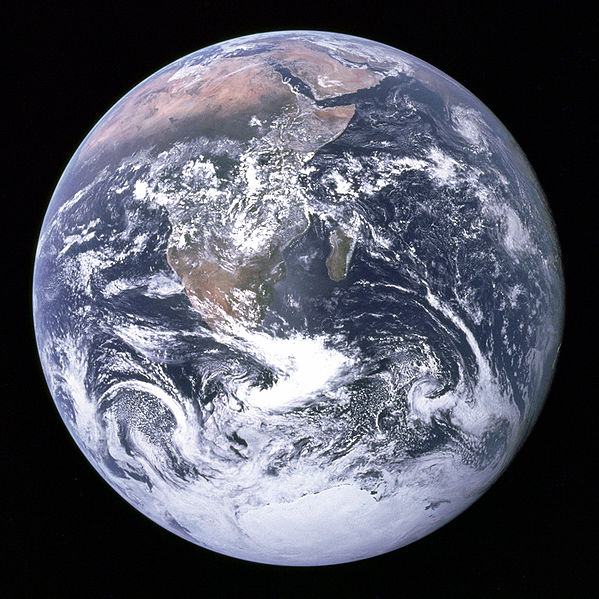 """""""The Blue Marble"""" is a famous photograph of the Earth taken on December 7, 1972, by the crew of the Apollo 17 spacecraft en route to the Moon at a distance of about 29,000 kilometres (18,000 mi). It shows Africa, Antarctica, and the Arabian Peninsula."""